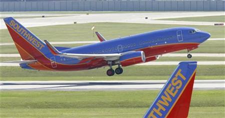 A Southwest Airlines Boeing 737 passenger jet takes off at Midway Airport in Chicago, Illinois in this July 24, 2008 file photo. REUTERS/Jeff Haynes/Files