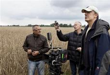 "Zbigniew Gustowski, assistant cameraman, Pawel Edelman, director of photography and Wladyslaw Paikowski, film director on set of the movie ""Poklosie"" (Aftermath) near Warsaw July 28, 2011. REUTERS/Apple Film Production/Marcin Makowski"
