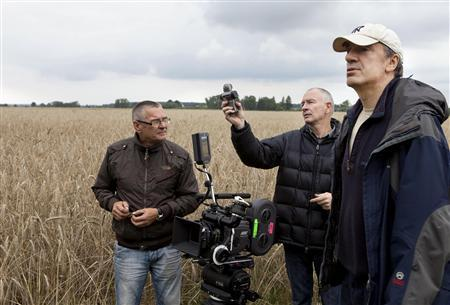 Zbigniew Gustowski, assistant cameraman, Pawel Edelman, director of photography and Wladyslaw Paikowski, film director on set of the movie ''Poklosie'' (Aftermath) near Warsaw July 28, 2011. REUTERS/Apple Film Production/Marcin Makowski