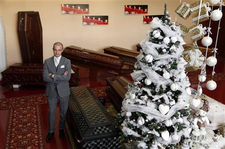 Alessandro Taffo, one of the owners of Taffo Funerals, poses at the company's show room in Rome December 14, 2012. REUTERS/Alessandro Bianchi
