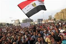 Anti-Mursi protesters chant anti-government slogans at Tahrir Square in Cairo December 14, 2012. Flag-waving supporters of Egyptian President Mohamed Mursi staged a final rally on Friday before a divisive referendum on a new constitution that the Islamist leader hopes will bring an end to weeks of political crisis and street clashes. REUTERS/Mohamed Abd El Ghany (EGYPT - Tags: POLITICS CIVIL UNREST)