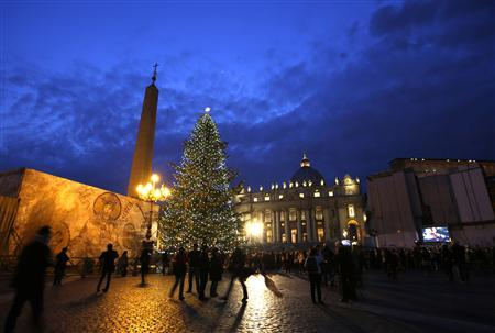 The Vatican Christmas tree is lit up after a ceremony in Saint Peter's Square at the Vatican December 14, 2012. REUTERS/Max Rossi