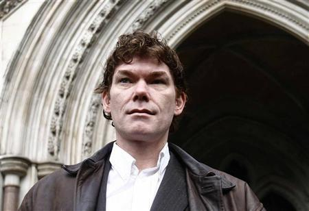 Computer hacker Gary McKinnon is seen posing after arriving at the High Court in London in this January 20, 2009 file photograph. REUTERS/Andrew Winning/Files