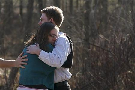 Family members embrace each other outside Sandy Hook Elementary School after a shooting in Newtown, Connecticut, December 14, 2012. At least 27 people, including children, were killed on Friday when at least one shooter opened fire at an elementary school in Newtown, Connecticut, CBS News reported, citing unnamed officials. REUTERS/Adrees Latif (UNITED STATES - Tags: CRIME LAW EDUCATION)