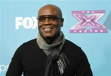 "Judge L.A. Reid poses at the party for the television series ""The X Factor"" finalists in Los Angeles, California November 5, 2012. REUTERS/Mario Anzuoni"