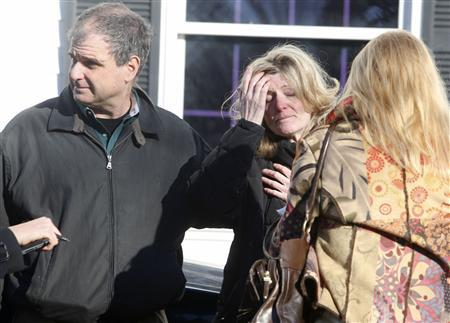 Relatives react outside Sandy Hook Elementary School following a shooting in Newtown, Connecticut, December 14, 2012. REUTERS/Michelle McLoughlin