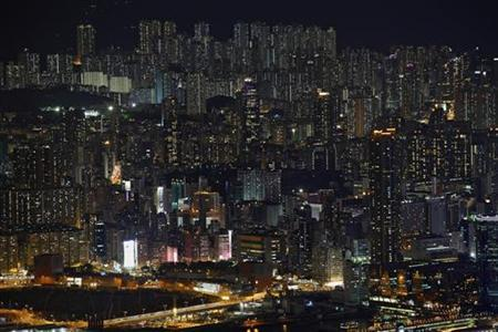 Buildings are seen on a hillside in Hong Kong June 19, 2012. REUTERS/Bobby Yip/Files