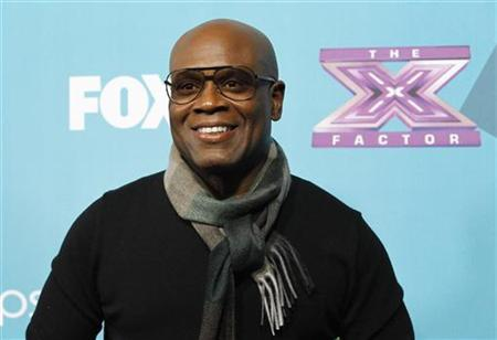 Judge L.A. Reid poses at the party for the television series ''The X Factor'' finalists in Los Angeles, California November 5, 2012. REUTERS/Mario Anzuoni/Files