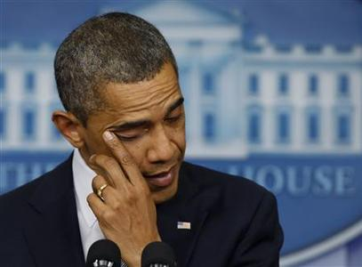 U.S. President Barack Obama wipes a tear as he speaks about the shooting at Sandy Hook Elementary School in Newtown, Connecticut, during a press briefing at the White House in Washington December 14, 2012. REUTERS/Larry Downing