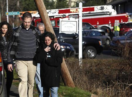Families leave the Sandy Hook Volunteer Fire Department near the Sandy Hook Elementary School in Newtown, Connecticut, December 14, 2012. REUTERS/Michelle McLoughlin