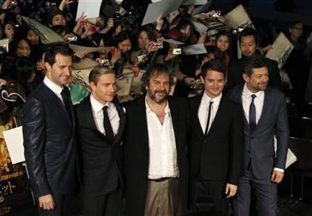 New Zealand director Peter Jackson (C) and cast members Richard Armitage (L), Martin Freeman (2nd L), Elijah Wood (2nd R) and Andy Serkis attend the Japan premiere of their movie 'The Hobbit - An Unexpected Journey' in Tokyo December 1, 2012. REUTERS/Issei Kato
