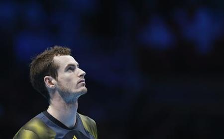 Britain's Andy Murray reacts just before match point during his men's singles semi-final tennis match against Switzerland's Roger Federer at the ATP World Tour Finals at the O2 Arena in London November 11, 2012. REUTERS/Suzanne Plunkett/Files