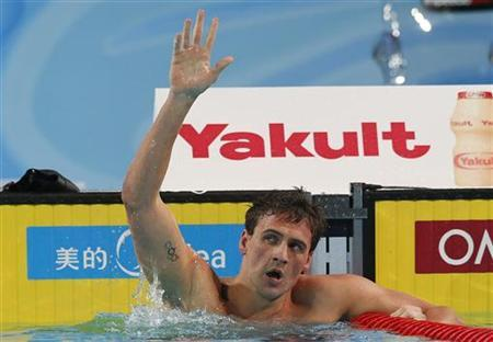 Ryan Lochte of the U.S. celebrates winning the men's 200m individual medley final during the FINA World Swimming Championships in Istanbul December 14, 2012. REUTERS/Murad Sezer