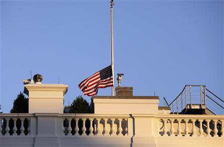 A U.S. flag flies at half mast at the White House in Washington December 14, 2012. A tearful President Barack Obama expressed ''overwhelming grief'' on Friday for the victims of a shooting rampage at Sandy Hook Elementary School and called on Americans to set aside politics and take ''meaningful action'' to prevent further tragedies of this kind. REUTERS/Yuri Gripas