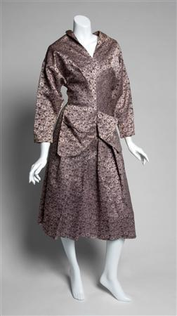 A black and pink two piece ensemble that belonged to actress Greta Garbo is shown in this publicity photo released to Reuters December 14, 2012. An auction of film legend Garbo's belongings got off to a roaring start on Friday, with her clothing, jewelry and other memorabilia fetching more than ten times pre-sale estimates in many cases. REUTERS/Julien's Auctions/Handout