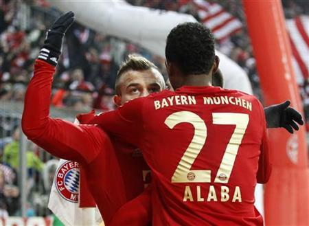 Bayern Munich's Xherdan Shaqiri (L) celebrates with David Alaba after scoring a goal during their German Bundesliga first division soccer match in Munich December 14, 2012. REUTERS/Dominic Ebenbichler