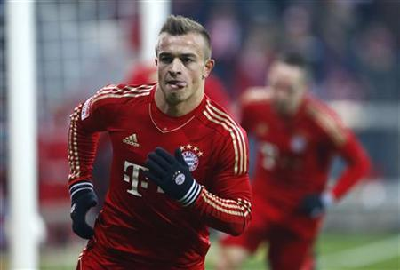 Bayern Munich's Xerdan Shaqiri celebrates after scoring a goal during their German Bundesliga first division soccer match in Munich December 14, 2012. REUTERS/Dominic Ebenbichler