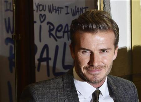 Soccer player David Beckham, the husband of former Spice Girls singer Victoria Beckham, arrives for the premiere of the musical ''Viva Forever!'', based on the music of the Spice Girls, in central London December 11, 2012. REUTERS/Toby Melville