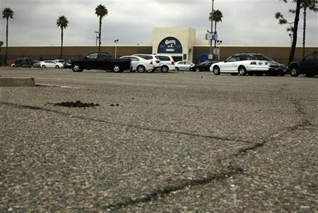 Cracks in the parking lot are seen in front of the Carousel shopping mall in San Bernardino, California September 11, 2012. REUTERS/Lucy Nicholson