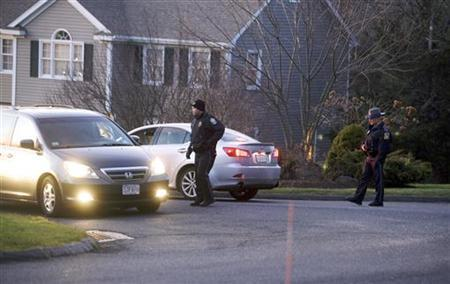 Police block streets near the secondary crime scene following a shooting at Sandy Hook Elementary School, in Sandy Hook, Connecticut, December 14, 2012. REUTERS/Michelle McLoughlin