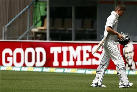 Australia's captain Michael Clarke reacts as he walks off the ground after being dismissed for 74 runs during the second day's play in the first cricket test match against Sri Lanka at Bellerive Oval in Hobart December 15, 2012. REUTERS/David Gray