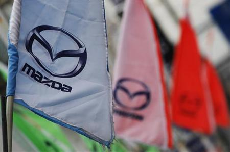 Logos of Mazda Motor Corp are seen at a dealership in Tokyo March 1, 2012. REUTERS/Toru Hanai/Files