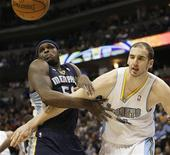 Memphis Grizzlies forward Zach Randolph (L) and Denver Nuggets center Kosta Koufos chase down a rebound in the second quarter of their NBA basketball game in Denver December 14, 2012. REUTERS/Rick Wilking