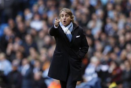 Manchester City manager Roberto Mancini gestures during their English Premier League soccer match against Manchester United at The Etihad Stadium in Manchester, northern England December 9, 2012. REUTERS/Eddie Keogh