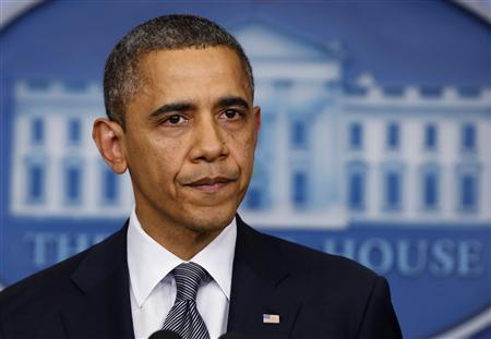 Obama urges solidarity as America mourns shooting victims