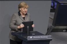 German Chancellor Angela Merkel delivers a government policy statement before the German lower house of parliament, the Bundestag, in Berlin, December 13, 2012. REUTERS/Thomas Peter (GERMANY - Tags: POLITICS)