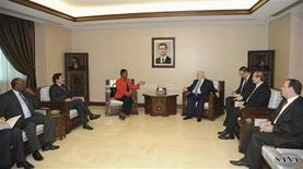 Syria's Foreign Minister Walid al-Moualem (centre R) meets U.N. humanitarian chief Valerie Amos (centre L) in Damascus December 15, 2012, in this handout photograph released by Syria's national news agency (SANA)