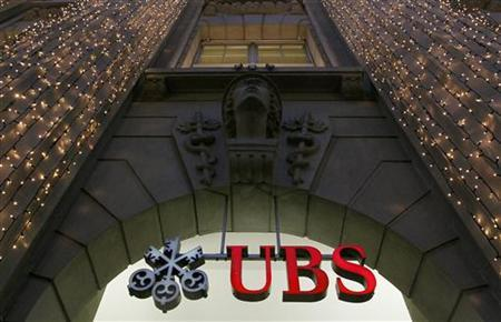 Christmas lights are illuminated at an office building of Swiss bank UBS in Zurich December 4, 2012. REUTERS/Arnd Wiegmann