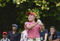 Yoshinori Fujimoto of Japan watches his tee shot on the 16th hole during the Royal Trophy golf tournament between Asia and Europe in Bandar Seri Begawan December 15, 2012. REUTERS/Ahim Rani