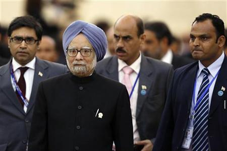 Prime Minister Manmohan Singh (2nd L) is followed by his staff as he leaves a session of the 21st ASEAN (Association of Southeast Asian Nations) and East Asia summits in Phnom Penh November 20, 2012. REUTERS/Samrang Pring/Files