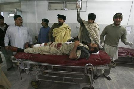 A man who was injured during a rocket attack receives medical treatment at a hospital in Peshawar December 15, 2012. Four people were killed when militants attacked the airport in the northwestern city of Peshawar on Saturday and traded gunfire with soldiers for more than 30 minutes before being repulsed, military and health officials said. REUTERS/Khuram Parvez