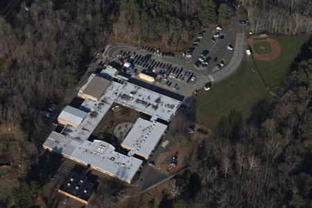 Sandy Hook Elementary School is seen in this aerial photograph a day after a mass shooting in Newtown, Connecticut December 15, 2012. REUTERS/Adrees Latif