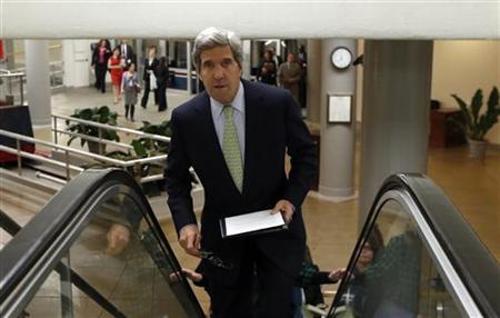 U.S. Senator John Kerry arrives in the Capitol in Washington December 13, 2012. REUTERS/Kevin Lamarque