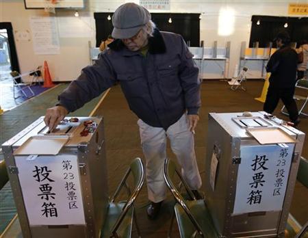 A voter casts his ballot at a polling station in Kawasaki, near Tokyo December 16, 2012. REUTERS/Yuriko Nakao