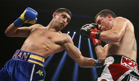Amir Khan of Britain (L) lands a punch on Carlos Molina during their WBC Silver Super Lightweight title bout in Los Angeles, California, December 15, 2012. REUTERS/Lucy Nicholson