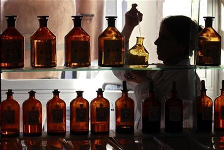 An assistant mixes essences in the laboratory at the Galimard perfume factory in Grasse, southeastern France, November 14, 2012. REUTERS/Eric Gaillard/Files