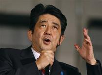 Japan's main opposition Liberal Democratic Party's (LDP) leader and former Prime Minister Shinzo Abe delivers a speech at Akihabara electronics store district in Tokyo December 15, 2012, on the last election campaign day ahead of Sunday's general election. REUTERS/Yuriko Nakao