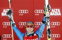Ted Ligety of the U.S. celebrates on podium after winning the men's World Cup giant slalom race in Alta Badia, northern Italy, December 16, 2012. REUTERS/Alessandro Garofalo