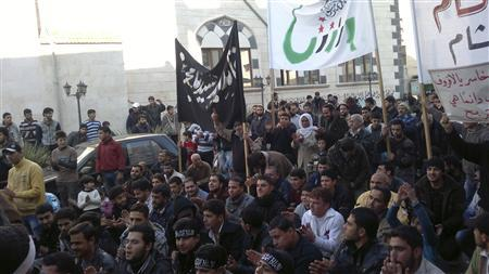 Demonstrators protest against Syria's President Bashar al-Assad in Binsh, near Idlib December 14, 2012. The banner in the centre reads: ''Our leader forever Prophet Muhammad''. REUTERS/Hamzeh Al-Binishi/Shaam News Network/Handout