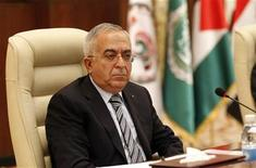Palestinian Prime Minister Salam Fayyad attends the opening session of an international conference of solidarity with the Palestinian and Arab prisoners and detainees in Israel's prisons, in Baghdad December 11, 2012. REUTERS/Thaier Al-Sudani