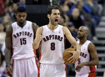 Toronto Raptors guard Jose Calderon (C) reacts in front of teammates Amir Johnson (L) and John Lucas III after drawing a penalty to the Houston Rockets during the second half of their NBA basketball game in Toronto December 16, 2012. REUTERS/Mike Cassese