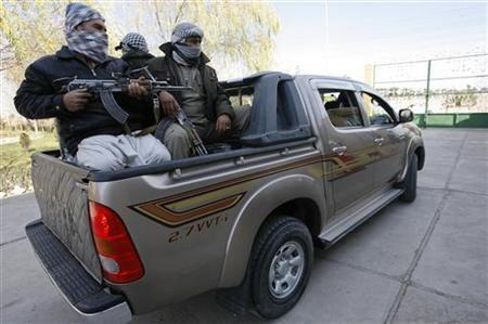 An Afghan businessman travels with his security personnels in Herat province December 11, 2012. REUTERS/Mohammad Shoib