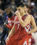 Houston Rockets guard Jeremy Lin and James Harden (L) walk of the court after losing their NBA basketball game against the Toronto Raptors in Toronto December 16, 2012. REUTERS/Mike Cassese