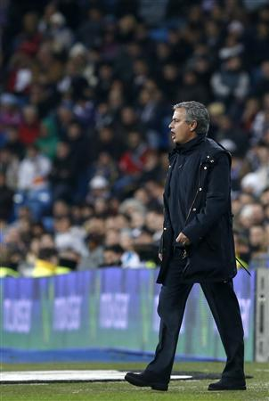 Real Madrid's coach Jose Mourinho gestures during their Spanish First Division soccer match against Espanyol at Santiago Bernabeu Stadium in Madrid December 16, 2012. REUTERS/Juan Medina