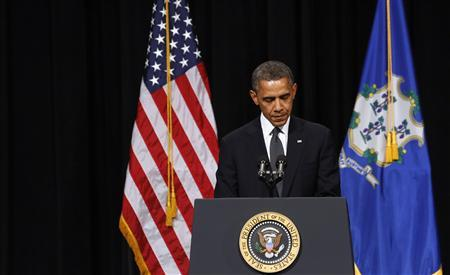 U.S. President Barack Obama speaks at a vigil held at Newtown High School for families of victims of the Sandy Hook Elementary School shooting in Newtown, Connecticut December 16, 2012. REUTERS/Kevin Lamarque