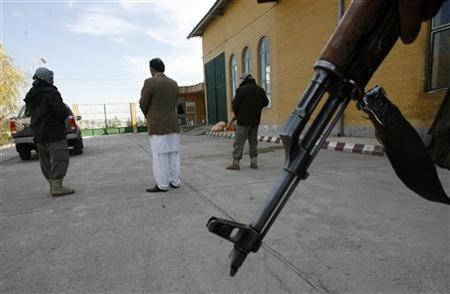 An Afghan businessman stands with his security personnels in Herat province December 11, 2012. REUTERS/Mohammad Shoib
